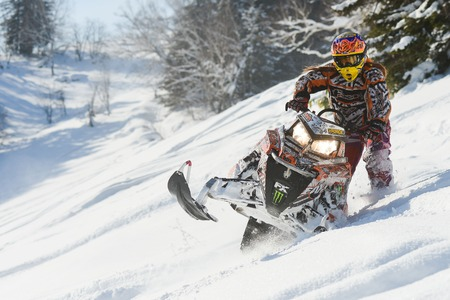 sakhalin: SAKHALIN RUSSIAN - JANUARY 23 : Oleg Bibikov moving snowmobile in winter forest in the mountains of Sakhalin Island in Sakhalin sprint 2015 Editorial