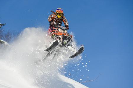 sakhalin: SAKHALIN RUSSIAN - JANUARY 23 : Oleg Bibikov moving snowmobile in winter forest in the mountains of Sakhalin Island in Sakhalin sprint 2015 Editorial