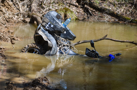 drowned: Khabarovsk , Russia - may 10, 2015 : Khabarovsk , Russia - may 10, 2015 : the ATV drowned in a large puddle Khabarovsk rally-2015