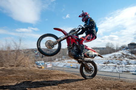 rear wheel: Khabarovsk , Russia - march 22, 2014 : Enduro motorcycle extreme rides on the rear wheel Editorial