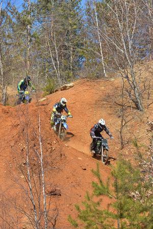 descend: Khabarovsk , Russia - may 10, 2015 : Enduro motorcycles descend from the steep slope on the mountain Editorial