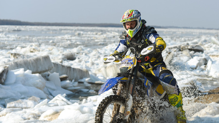 super cross: Khabarovsk , Russia - may 10, 2015 : Enduro motorcycles are riding on rastasia ice on the river Editorial