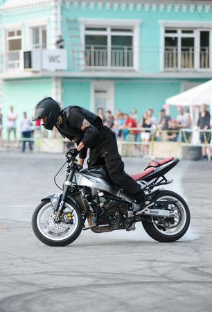 stunt: Khabarovsk Russia - July 11, 2015 : a  stunt rider on a sport bike ,on a stunt battle,  July 11, 2015 in Khabarovsk Russia Editorial