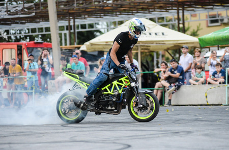 Khabarovsk Russia - July 11, 2015 : a  stunt rider on a sport bike ,on a stunt battle,  July 11, 2015 in Khabarovsk Russia Editorial