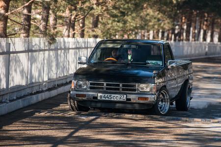 Khabarovsk, Russia - March 3, 2016 : car Nissan Datsun pickup truck on the street, in winter Editorial