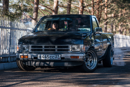 farm duties: Khabarovsk, Russia - March 3, 2016 : car Nissan Datsun pickup truck on the street, in winter Editorial