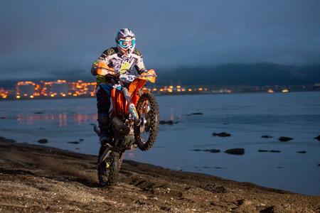 Yuzhno-Sakhalinsk , Russia - motorcycle Enduro riding wheelies on the beach Editorial