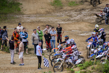 struggle: Yuzhno-Sakhalinsk , Russia - August 14, 2015: the struggle of motorcyclists on Enduro competitions hard Enduro no place to run Editorial