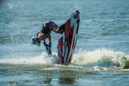 moto acuatica: Khabarovsk, Russia - July 28, 2015: Man on jet ski turns with much splashes
