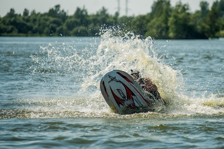 moto acuatica: Khabarovsk, Russia - July 28, 2015: Man on jet ski turns with much splashes