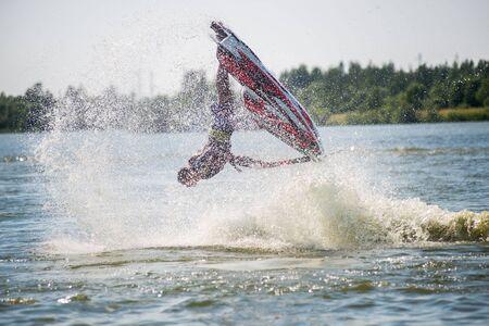 jet ski: Khabarovsk, Russia - July 28, 2015: Man on jet ski turns with much splashes