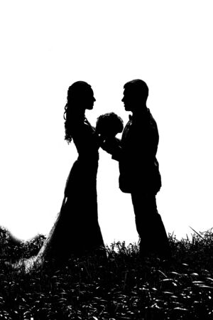 role models: silhouette of bride and groom in the grass on a white background