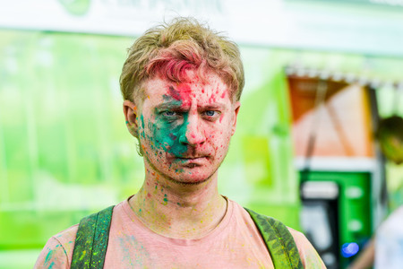 mob: Khabarovsk, Russia - June 25, 2016: Tourist with students celebrating Holi on 25 July 2016 in Khabarovsk, Russia. Holi is a spring festival celebrated as a festival of colors.