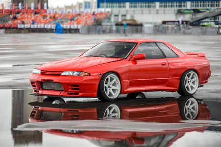 nissan: driver drives a Nissan skyline R 32 red, on pools 9 July 2016 in Khabarovsk, Russia