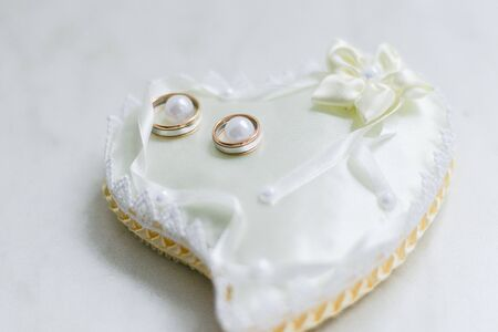 wedding rings in a basket for rings Stock Photo