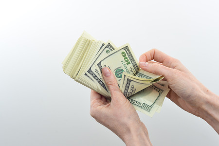 believes: girl believes the dollars in hand on white background Stock Photo