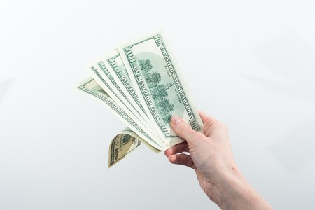 girl believes the dollars in hand on white background Stock Photo