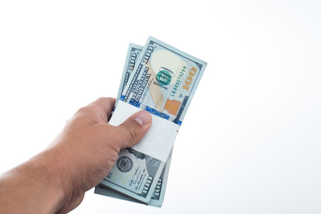 believes: men believes the dollars in hand on white background Stock Photo