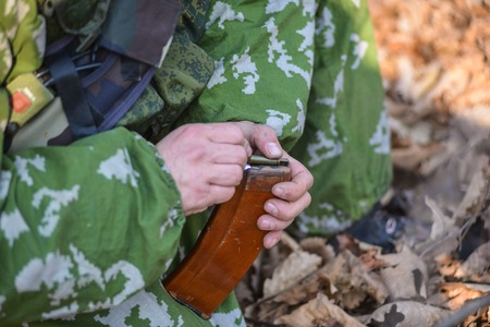 power rangers: Russian soldiers charging machine cartridges close up