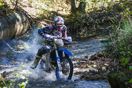 VLADIVOSTOK, RUSSIA - OCTOBER 10: competition On the edge 2016 Hard Enduro Rally with a KTM motorcycle. The hardest enduro rally in the world. October 10, 2016 in Vladivostok, Russia Editorial