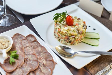 Assorted deli meats - ham, sausage, salami, parma prosciutto bacon fat salad language Stock Photo