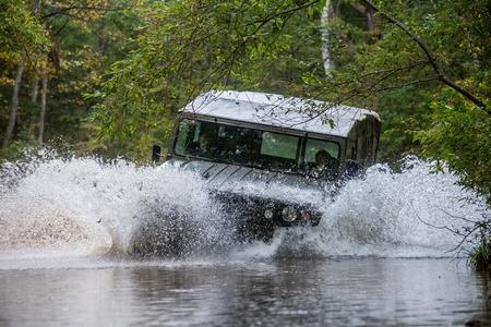 VLADIVOSTOK, RUSSIA - SEPTEMBER 22, 2015: Motor car Toyota Mega Cruiser driving on a forest road Editorial