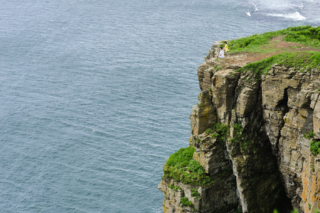 blue sky, high cliffs, the waves of the sea Stock Photo