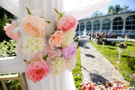 Wedding decoration ceremony Chandelier in the arch of flowers Stock Photo