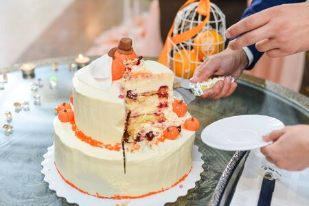 Wedding cake with red roses wedding cake. orange