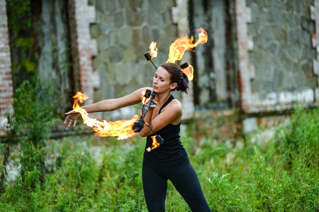 baton: play with fire show on the shore of the sea