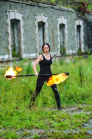 Fire show girl with flaming torches