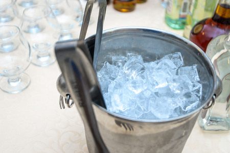 dinne: on the table a bucket with ice for drinks Stock Photo