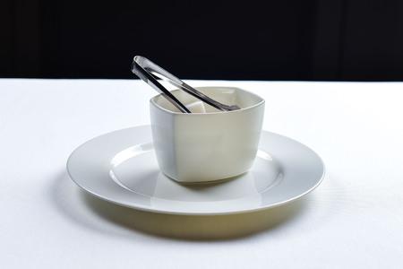 White refined sugar in a ceramic bowl Stock Photo