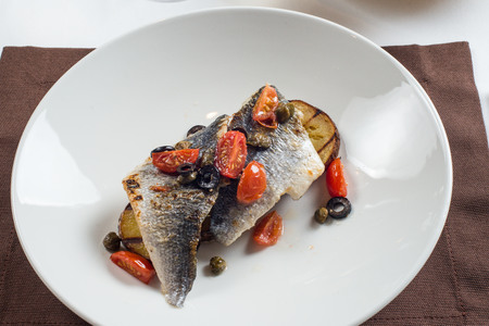 Grilled fish with roasted potatoes Stock Photo