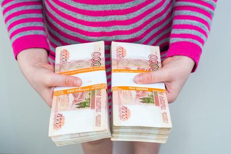 closeup humans hands holding russian rubles