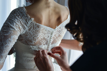 Garter on the leg of a bride, Wedding day moments