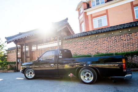 Khabarovsk, Russia - August 28, 2016 : car Nissan Datsun pickup truck on the street, around the house