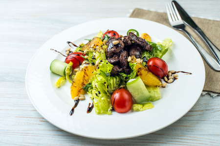 salad with beef liver and citrus fruits