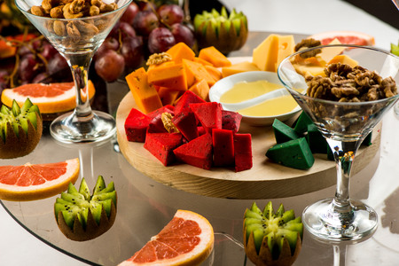 Assortment of cheeses, fruits, and snacks for the holiday