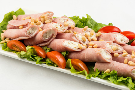 meat rolls with ham, cheese and greens, on white background Stock Photo