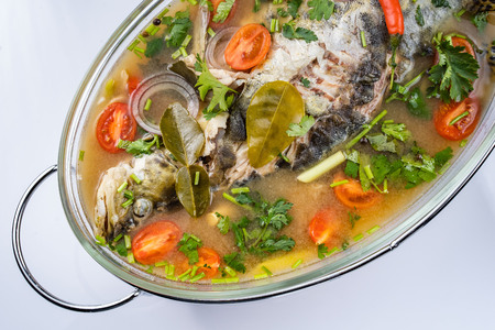 Fried Steamed Sea Perch in Lime Soup Sauce Stock Photo