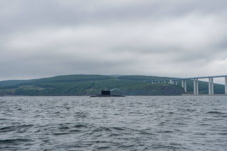 A line of modern russian military submarine cruisers in the row, northern fleet and baltic sea fleet in the open sea, submarine Stock Photo