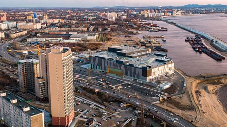 KHABAROVSK, RUSSIA - October 20, 2019 Khabarovsk shopping center Brosko mall the view from the top. filmed with a drone. amur river. residential complex pioneer