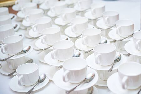 A lot of white coffee cups. Top view on many stacked in rows of empty clean white cups for tea or coffee Stockfoto - 137764692
