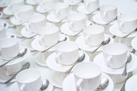 A lot of white coffee cups. Top view on many stacked in rows of empty clean white cups for tea or coffee Stockfoto - 137764695
