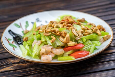 Vegetable dish, Chinese cooking salad pepper nuts Stockfoto - 140416297
