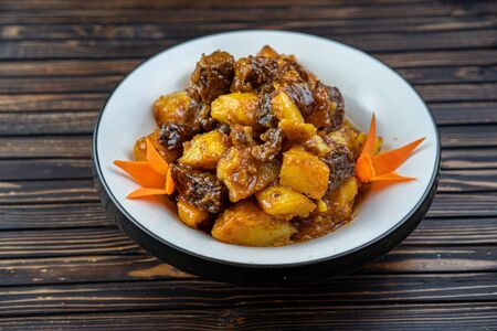 Beef stew with potatoes in a plate. Stockfoto - 140416331