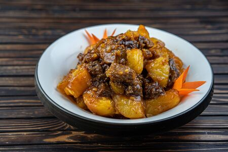 Beef stew with potatoes in a plate.