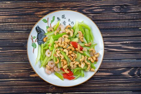 Vegetable dish, Chinese cooking salad pepper nuts Stockfoto - 140416439