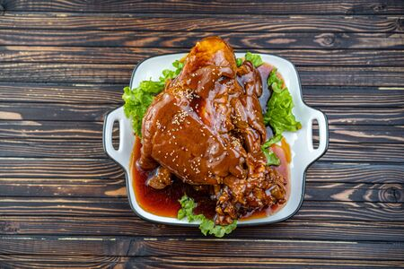 Roast pork knuckle served with boiled cabbage, bread, horseradish and mustard Stockfoto - 140416440